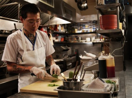 chef Danny Bowien cutting cucumber